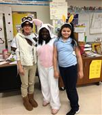 Mrs Wright and Ms Roundtree with a student as a book character